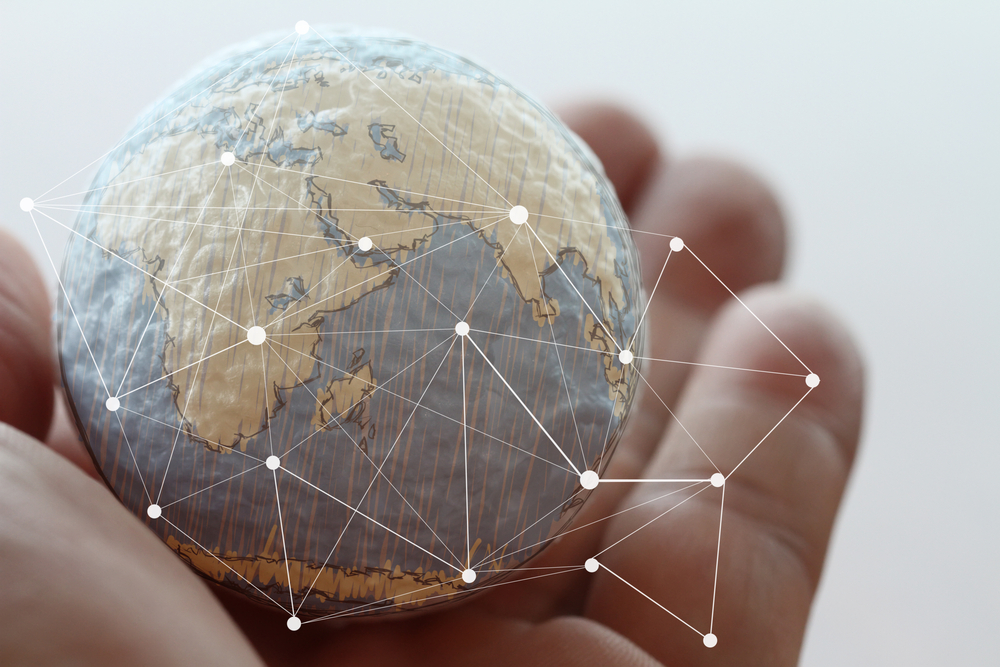 close up of businessman hand showing texture the world with digital social media network diagram concept Elements of this image furnished by NASA